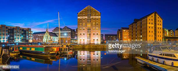 Gloucester Docks redeveloped warehouses narrowboat canal marina panorama illuminated dusk