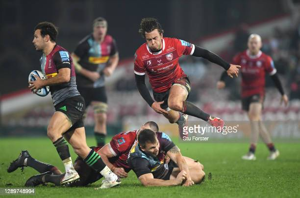 Gloucester fly half Lloyd Evans chases down Quins player Danny Care 1 during the Gallagher Premiership Rugby match between Gloucester and Harlequins...