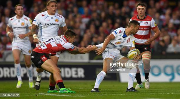 Gloucester fullback Jason Woodward gets to grips with Chiefs player Phil Dollman during the Aviva Premiership match between Gloucester Rugby and...
