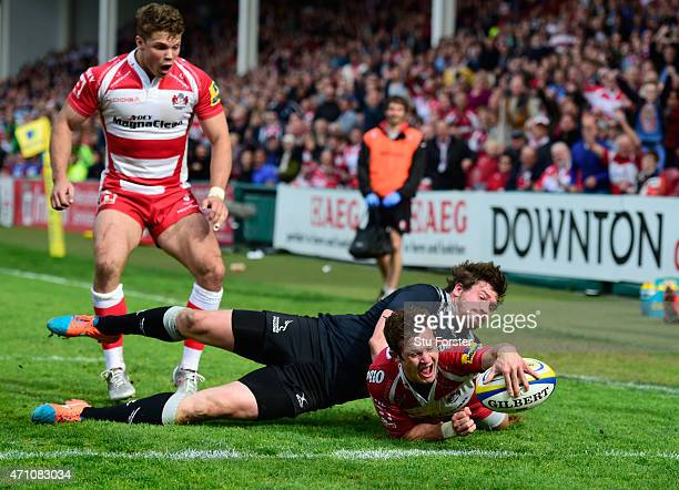Gloucester player Billy Burns scores the winning try despite the attentions of Adam Powell during the Aviva Premiership match between Gloucester...