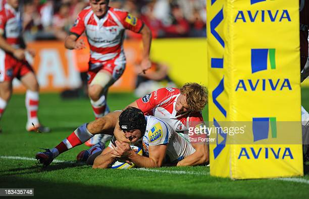 Gloucester player Billy Twelvetrees fails to stop Dean Mumm of Exeter from crossing to score during the Aviva Premiership match between Gloucester...