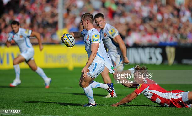 Gloucester player Billy Twelvetrees fails to stop Gareth Steenson of Exeter from breaking away during the Aviva Premiership match between Gloucester...