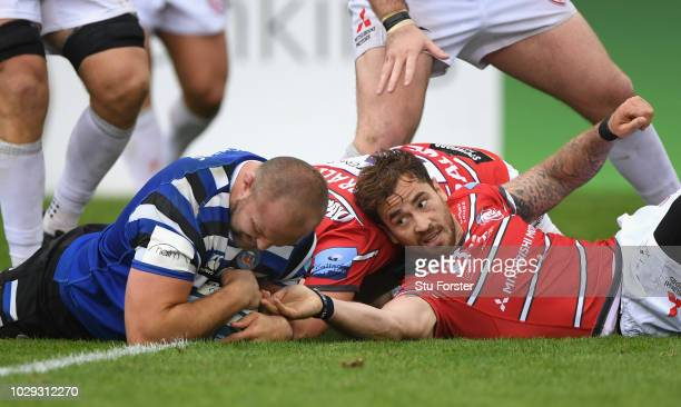 Gloucester player Danny Cipriani cant stop Bath player Tom Dunn going over to score a try during the Gallagher Premiership Rugby match between Bath...