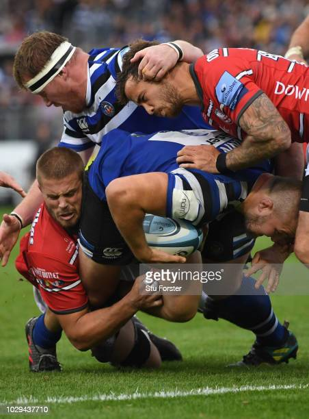 Gloucester player Danny Cipriani can't stop Bath player Tom Dunn charging towards the line during the Gallagher Premiership Rugby match between Bath...