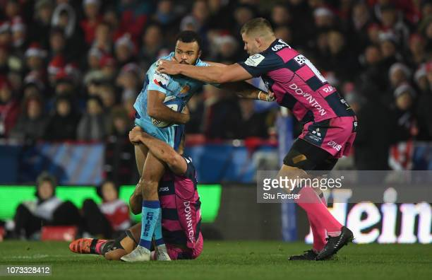 Gloucester player Ed Slater tackles Tom O' Flaherty of Exeter during the Champions Cup match between Gloucester Rugby and Exeter Chiefs at Kingsholm...