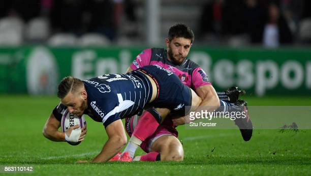 Gloucester player Owen Williams tackles Alban Conduche of Agen during the European Rugby Challenge Cup match between Gloucester Rugby and Agen at...