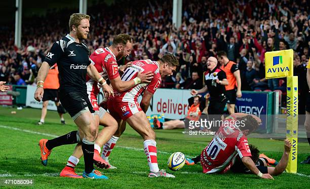 Gloucester players celebrate the winning try scored by Billy Burns as Alex Tait looks on during the Aviva Premiership match between Gloucester Rugby...