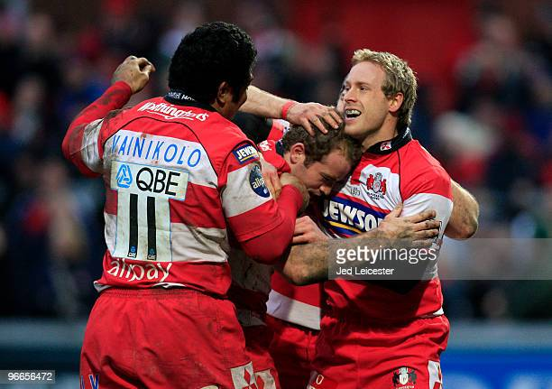 Gloucester players Olly Morgan and Lesley Vainikolo celebrate with try scorer James Simpson-Dainel during the Guinness Premiership match between...