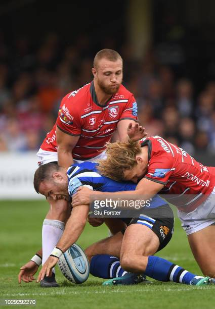 Gloucester players Ruan Ackermann and Billy Twelvetrees combine to thwart Bath centre Jamie Roberts during the Gallagher Premiership Rugby match...