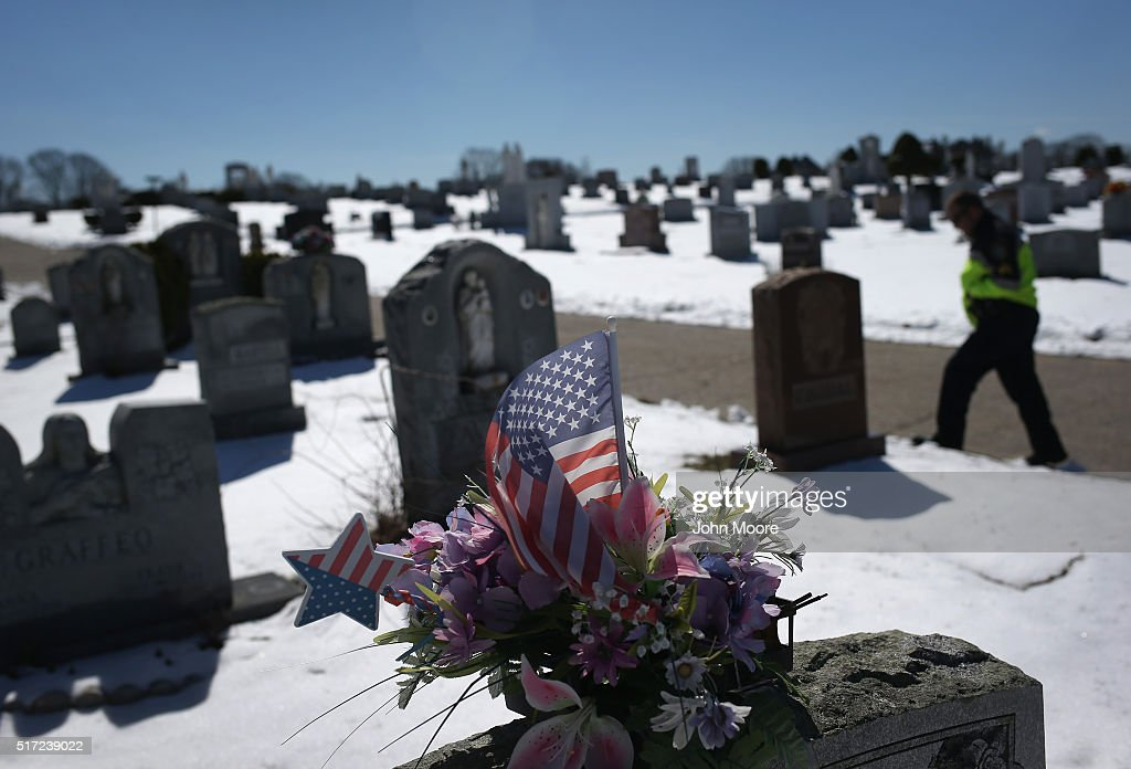 Gloucester police sergeant Jeremiah Nicastro walks through a cemetery after visiting the grave of a relative that died of heroin overdose on March 22, 2016 in Gloucester, MA. Gloucester and communities across New England are struggling with an epidemic of overdose deaths due to heroin and opioid pain pill addiction. On March 15, the U.S. Centers for Disease Control (CDC), announced guidelines for doctors to reduce the amount of opioid painkillers prescribed nationwide, in an effort to curb the epidemic. The CDC estimates that most new heroin addicts first became hooked on prescription pain medication before graduating to heroin, which is stronger and cheaper.