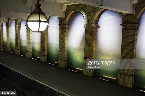 Gloucester Road underground station London UK A large scale photographic mural between the arches of this West London tube station brings landscape...