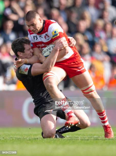 Gloucester Rugby's Jake Polledri is tackled by Exeter Chiefs' Ian Whitten during the Aviva Premiership match between Exeter Chiefs and Gloucester...