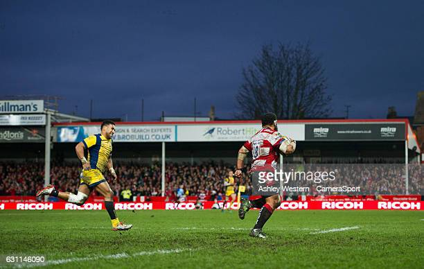 Gloucester Rugby's John Afoa evades the tackle of Worcester Warriors' Cooper Vuna to score his sides fourth try during the Aviva Premiership match...