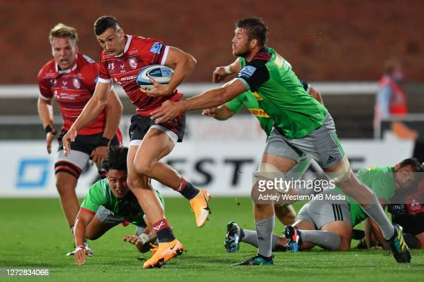 Gloucester Rugby's Jonny May is tackled by Harlequins' Marcus Smith and Stephan Lewies during the Gallagher Premiership Rugby match between...