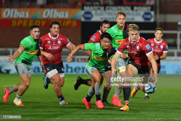 Gloucester Rugby's Ollie Thorley battles for possession with Harlequins' Marcus Smith during the Gallagher Premiership Rugby match between Gloucester...