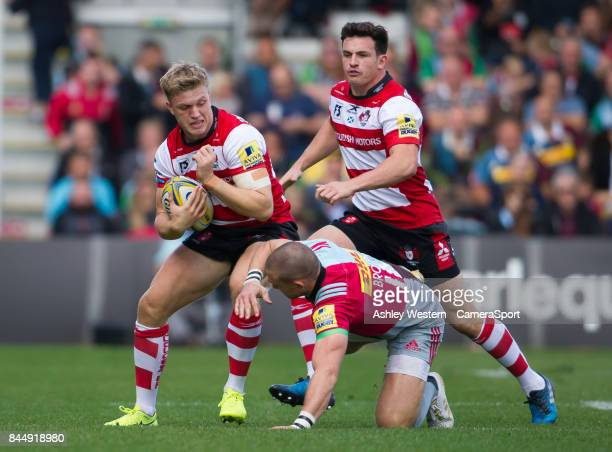 Gloucester Rugby's Ollie Thorley evades the tackle of Harlequins' Mike Brown during the Aviva Premiership match between Harlequins and Gloucester...