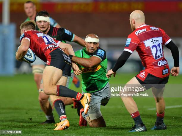 Gloucester Rugby's Ollie Thorley is tackled by Harlequins' Aaron Morris during the Gallagher Premiership Rugby match between Gloucester Rugby and...