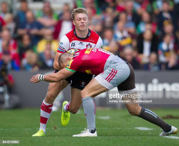 Gloucester Rugby's Ollie Thorley is tackled by Harlequins' Mike Brown during the Aviva Premiership match between Harlequins and Gloucester Rugby at...