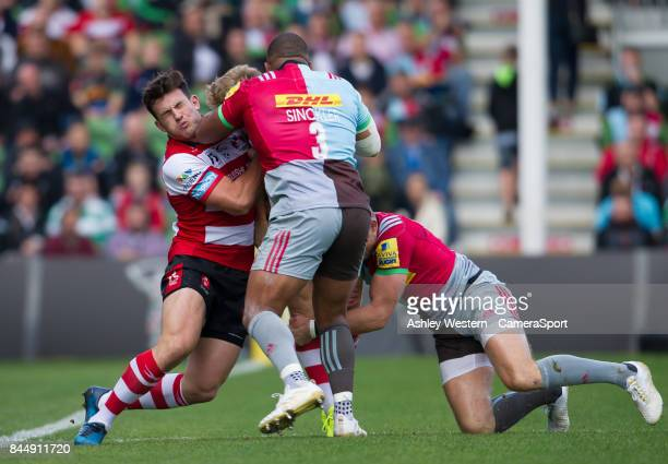 Gloucester Rugby's Ollie Thorley offloads to Matt Scott as he is tackled by Harlequins' Kyle Sinckler during the Aviva Premiership match between...