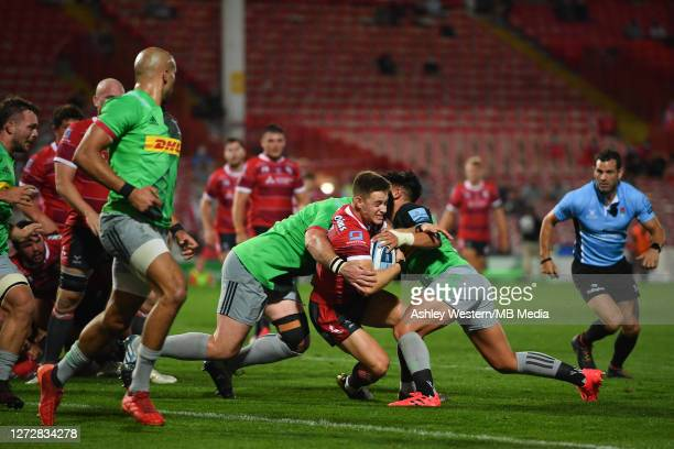 Gloucester Rugby's Stephen Varney is tackled by Harlequins' Marcus Smith and Will Collier during the Gallagher Premiership Rugby match between...