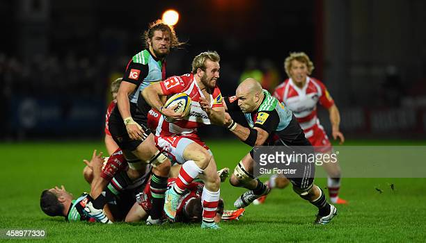 Gloucester scrum half Dan Robson is tackled by George Robson of Harlequins as he makes a break during the Aviva Premiership match between Gloucester...