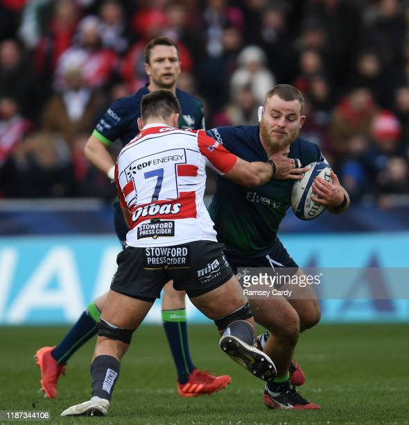 Gloucester , United Kingdom - 8 December 2019; Finlay Bealham of Connacht is tackled by Jake Polledri of Gloucester during the Heineken Champions Cup...
