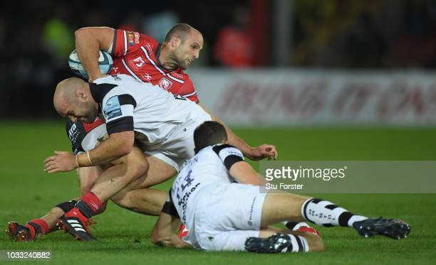 Gloucester wing Charlie Sharples is tackled by Shaun Malton during the Gallagher Premiership Rugby match between Gloucester Rugby and Bristol Bears...