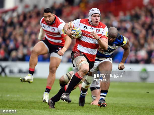 Gloucester's Ben Morgan evades the tackle of Bath Rugby's Beno Obano during the Aviva Premiership match between Gloucester Rugby and Bath Rugby at...