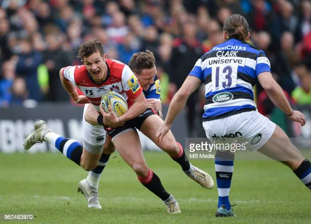 Gloucester's Billy Burns is tackled by Bath Rugbyâs James Wilson during the Aviva Premiership match between Gloucester Rugby and Bath Rugby at...