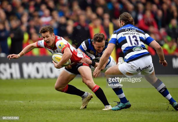 Gloucester's Billy Burns is tackled by Bath's James Wilson during the Aviva Premiership match between Gloucester Rugby and Bath Rugby at Kingsholm...