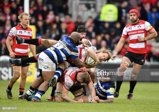 Gloucester's Billy Twelvetrees is tackled by Bath Rugby's Beno Obano during the Aviva Premiership match between Gloucester Rugby and Bath Rugby at...