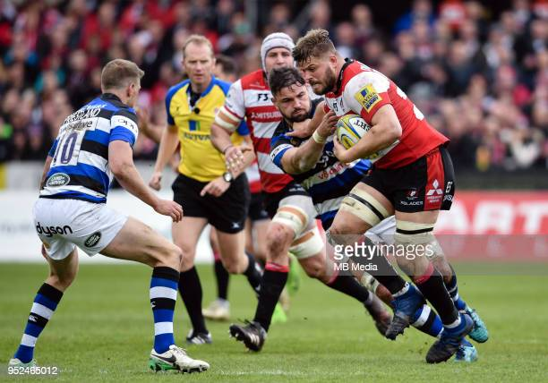Gloucester's Ed Slater holds off the challenge from Bath Rugby's Elliott Stooke during the Aviva Premiership match between Gloucester Rugby and Bath...