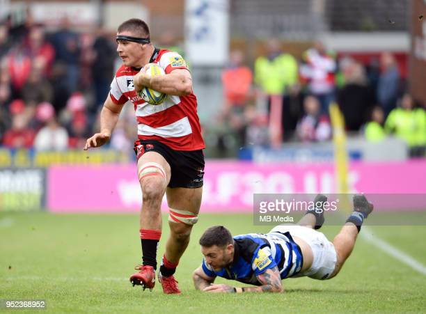Gloucester's Jake Polledri evades the tackle of Bath's Matt Banahan during the Aviva Premiership match between Gloucester Rugby and Bath Rugby at...