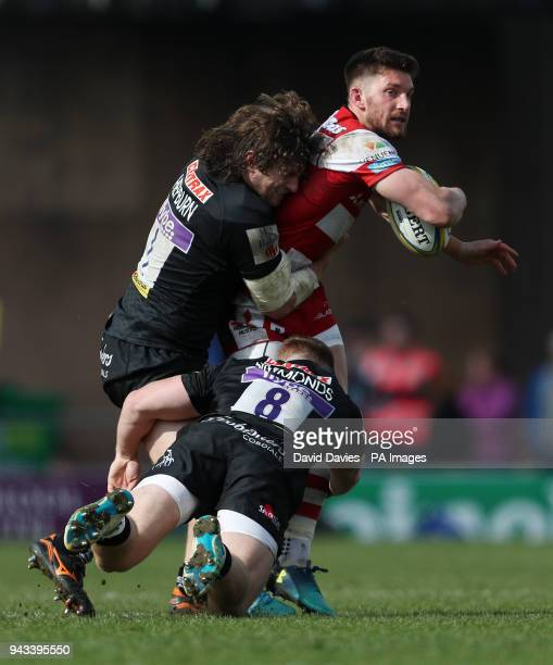 Gloucester's Owen Williams is tackled by Exeter's Alec Hepburn and Sam Simmonds during the Aviva Premiership match at Sandy Park Exeter