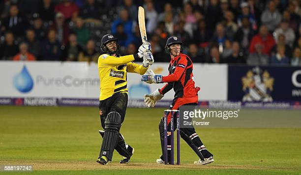 Gloucestershire batsman Jack Tayor hits out watched by Jets wicketkeeper Michael Richardson during the NatWest T20 Blast quarterfinal match between...