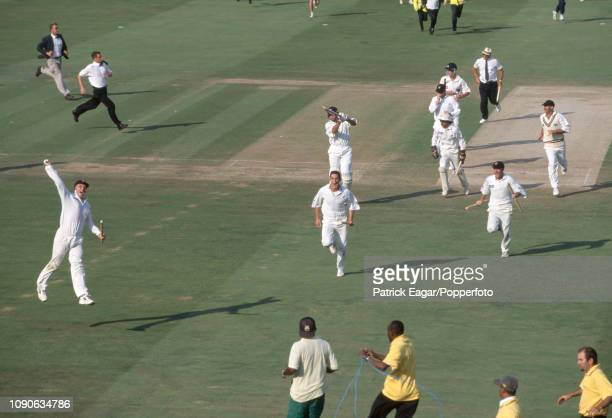 Gloucestershire bowler Jon Lewis leads the charge from the field after taking the final Yorkshire wicket to win the Benson and Hedges Super Cup Final...