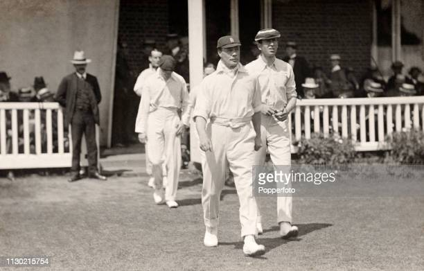 Gloucestershire captain Gilbert Jessop leading his team onto the field during their County Championship match against Kent at the St Lawrence Ground...