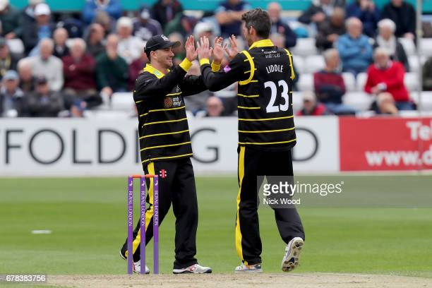 Gloucestershire captain Michael Klinger congratulates Chris Liddle on taking Tom Westleys wicket during the Royal London OneDay Cup between Essex...