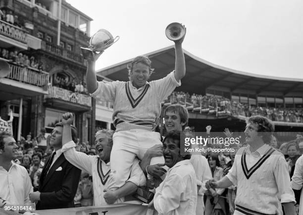 Gloucestershire captain Mike Procter, holding the Benson and Hedges Cup, is lifted onto the shoulders of his teammates after Gloucestershire won the...