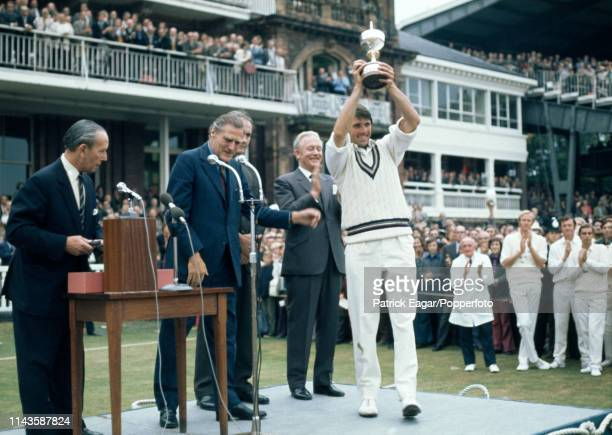 Gloucestershire captain Tony Brown raises the trophy after Gloucestershire beat Sussex in the Gillette Cup Final at Lord's Cricket Ground London 1st...