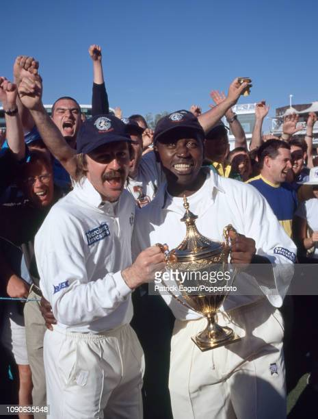Gloucestershire players Jack Russell and Mark Alleyne celebrate with the Benson and Hedges Cup and their supporters after winning the Benson and...