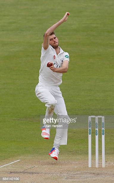 Gloustershire's David Payne bowls during day four of the Specsavers Division Two match between Gloucestershire and Northamptonshire at The County...