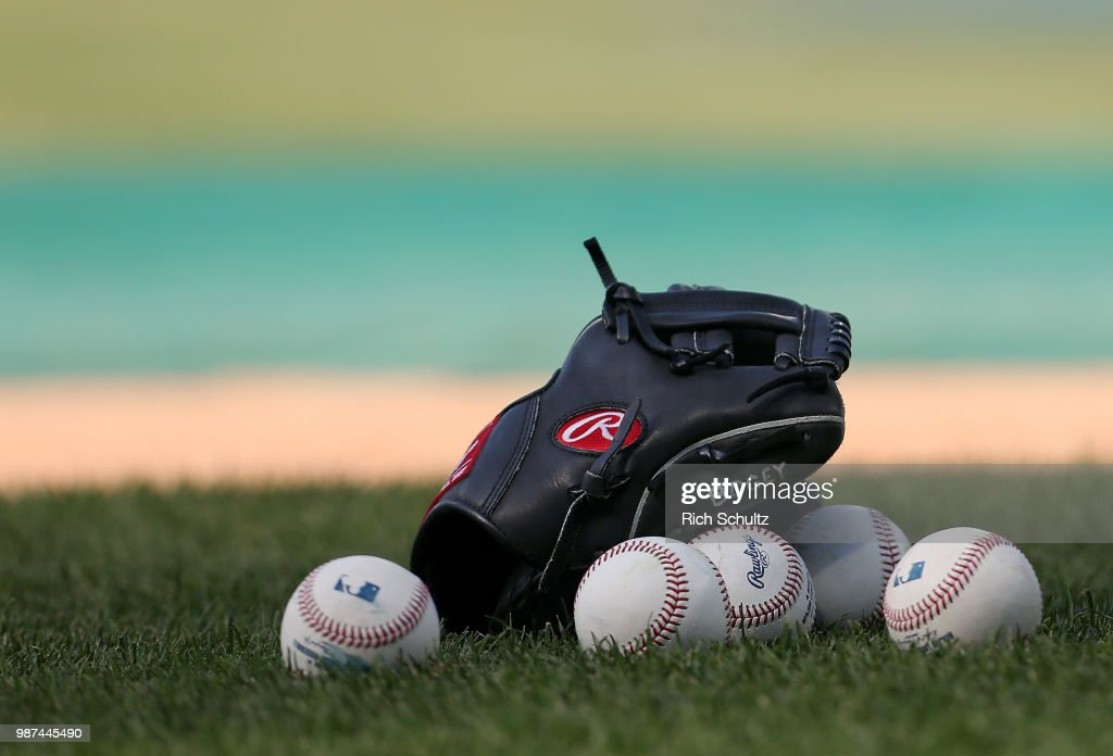 A glove and balls sit on the infield before a game between the Washington Nationals and Philadelphia Phillies at Citizens Bank Park on June 29, 2018 in Philadelphia, Pennsylvania.