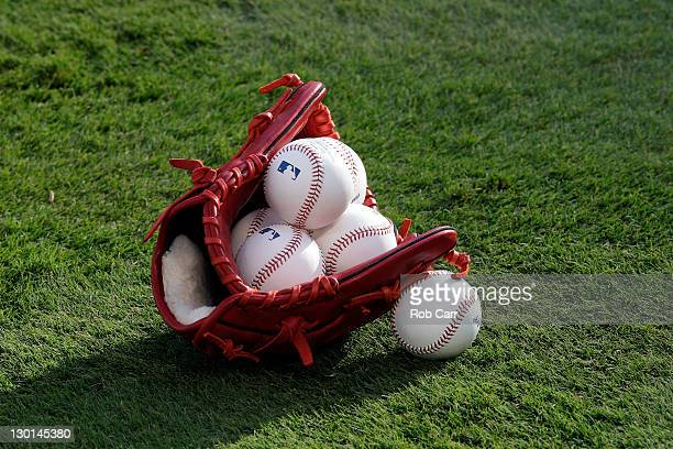 A glove and baseballs are seen on the field prior to Game Four of the MLB World Series between the St Louis Cardinals and the Texas Rangers at...