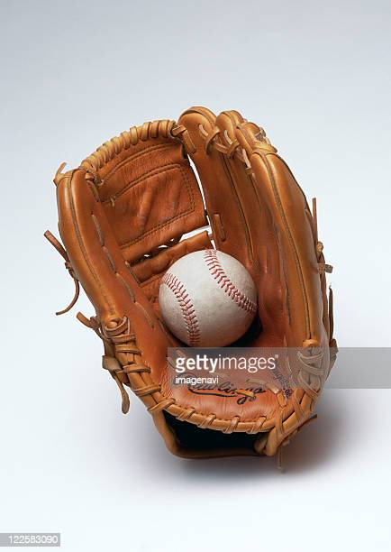 glove and hard ball - baseball glove stock pictures, royalty-free photos & images