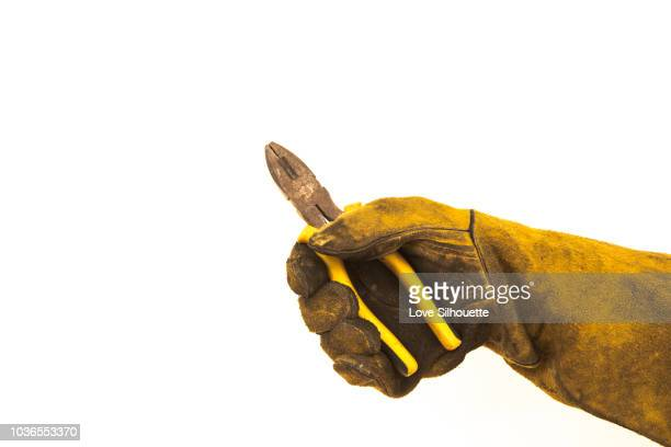 glove and pliers - brown glove stock pictures, royalty-free photos & images