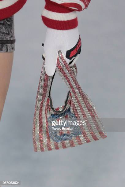 A glove and red blue and silver bag detail during the Alexander Wang Resort Runway show June 2018 New York Fashion Week on June 3 2018 in New York...