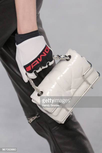 A glove and white clutch detail during the Alexander Wang Resort Runway show June 2018 New York Fashion Week on June 3 2018 in New York City
