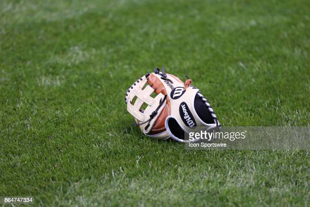 A glove lays on the field at Miller Park prior to the game between the Milwaukee Brewers and the Colorado Rockies on April 3 2017 at Miller Park in...