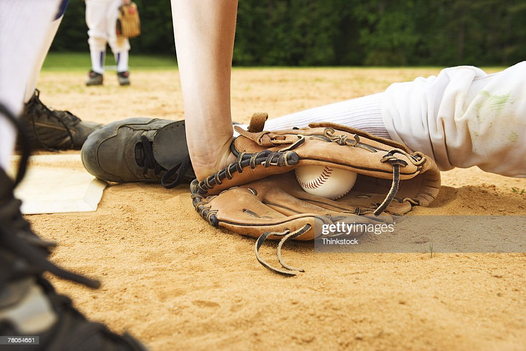 Glove of baseball player tagging runner out, maybe safe : Stock Photo